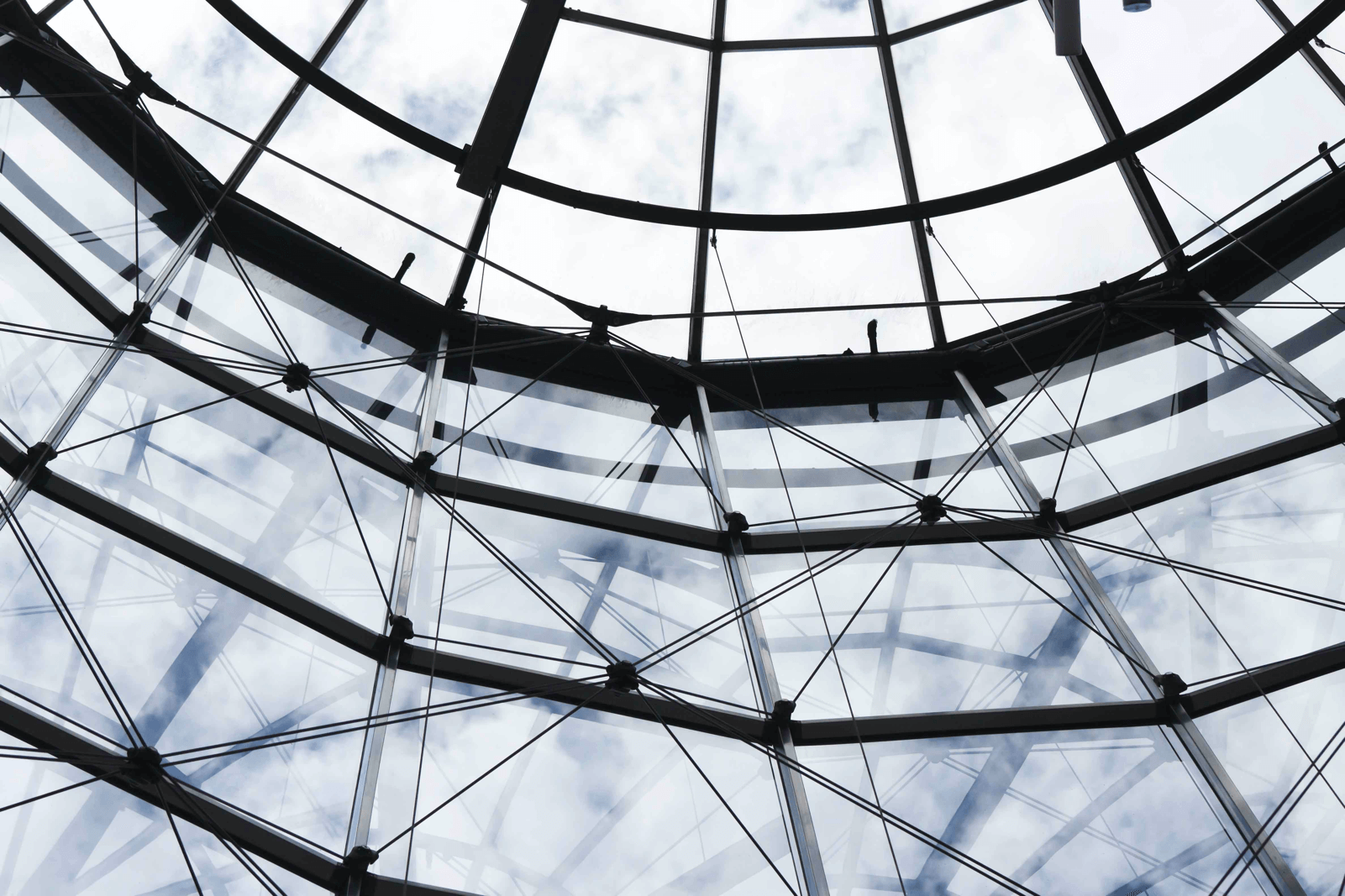 Photo taken from the inside of dome-shaped roof made of glass