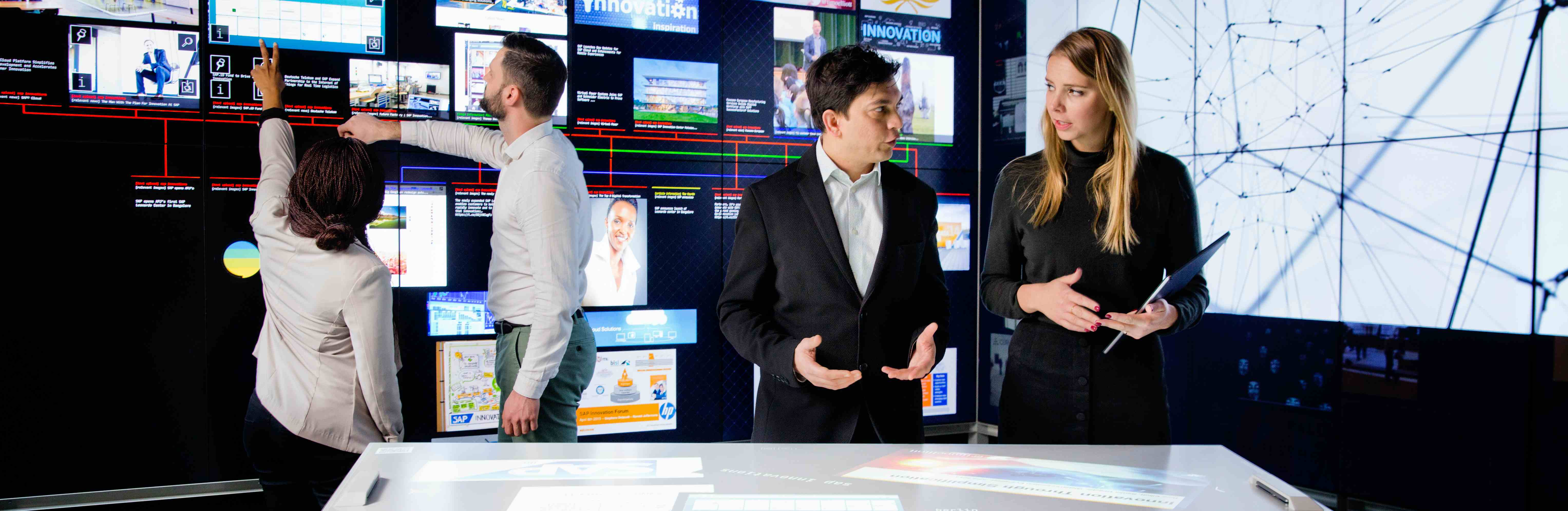 Photo of young people discussing in a high-tech lab