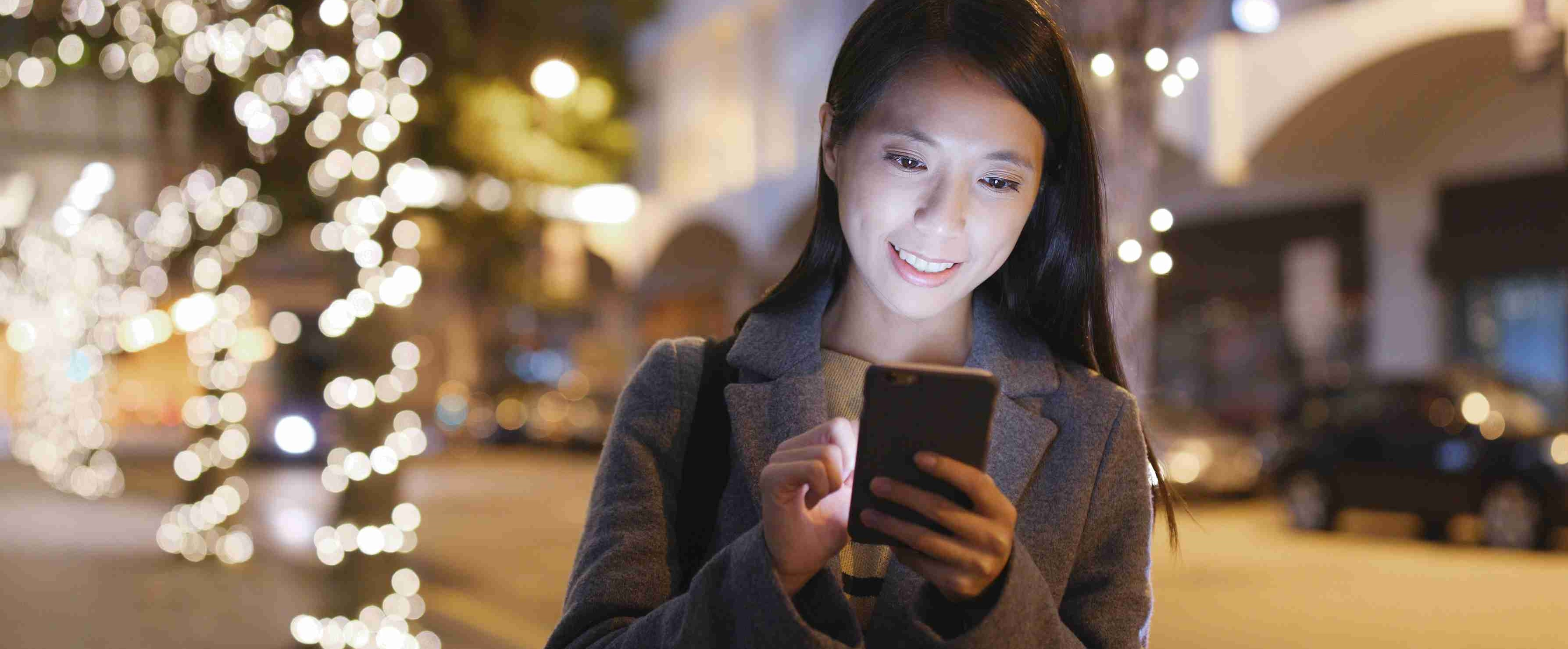 Image of a woman with mobile phone