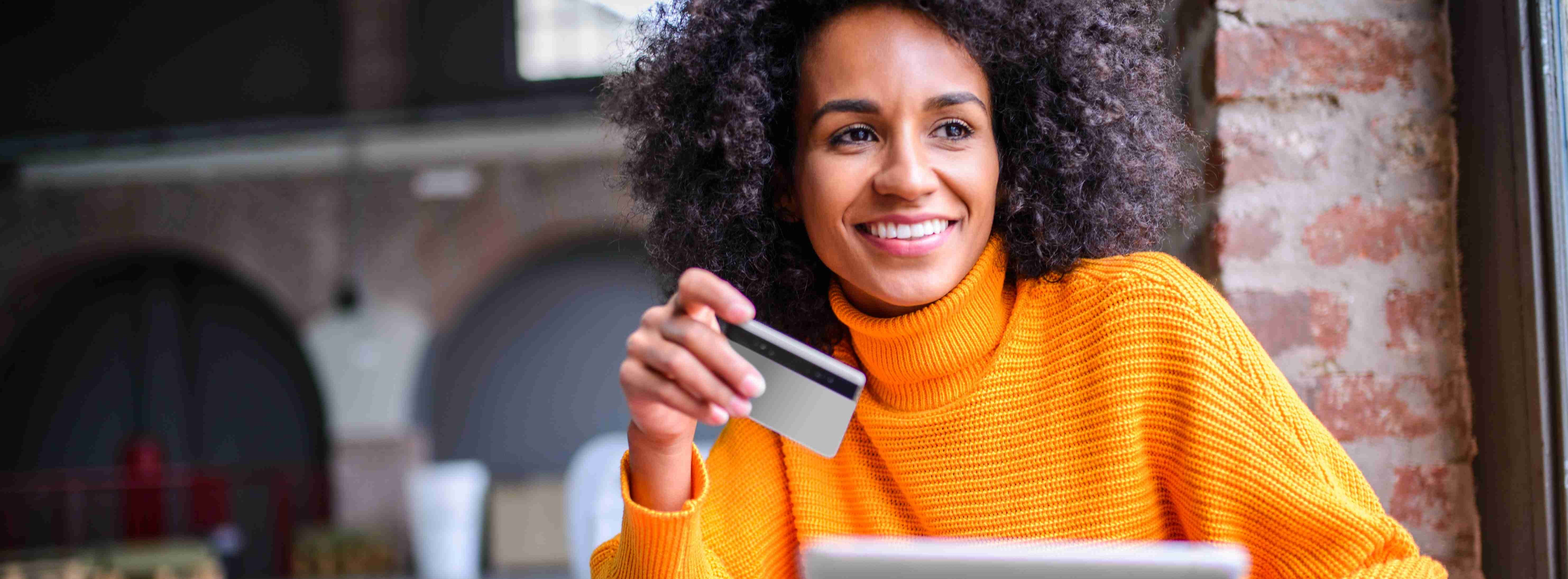 Image of a women with credit card