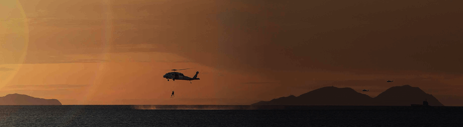 Photos of helicopters over water