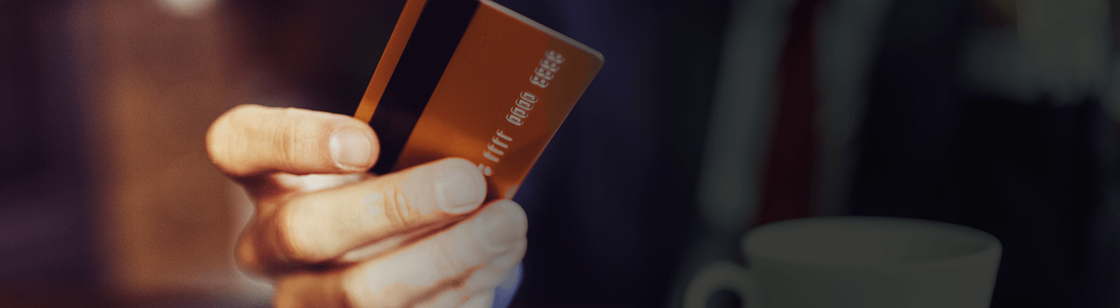Photo of a hand holding a credit card